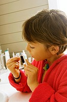 Boy cleaning his nail with a nail brush