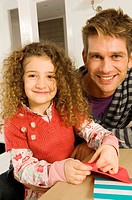 Portrait of a girl smiling with her father