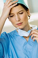 Close-up of a female doctor looking stressed (thumbnail)