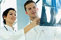 Close_up of two doctors examining an X_Ray report
