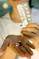 Close_up of pills on a doctor's palm