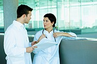Two doctors discussing a medical record
