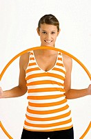 Portrait of a young woman holding a plastic hoop