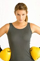 Portrait of a female boxer with arms akimbo (thumbnail)