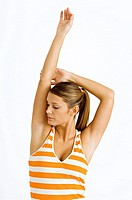 Close_up of a young woman stretching