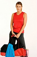 Portrait of a young woman holding a gym bag