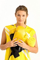 Portrait of a female boxer holding boxing gloves and a towel