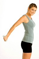 Portrait of a young woman exercising with a dumbbell