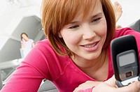 Close_up of a young woman using a mobile phone