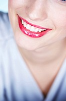 Young smiling woman, close_up of mouth
