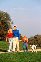 family with Dalmatian dog _ walk