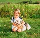 girl with Polish Lowland Sheepdog