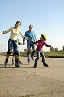 Family inline skating on road