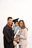 Graduating man with family