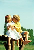 girl and boy on fence _ kissing