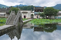 Bridge across pond, Hongcun, Anhui, China