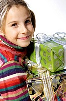 Portrait of girl holding christmas gifts and smiling