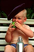 baby with beret , apple and bottle