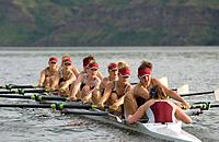 Rowing team practicing in lake