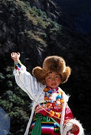 Portrait of girl posing in traditional clothing, Lijiang, China
