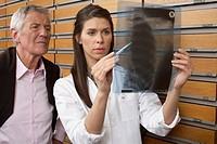 Female pharmacist watching old man´s x_ray