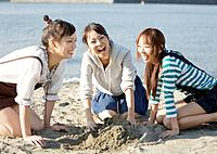 Women playing with sand