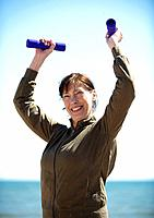 Mature woman exercising with hand weight