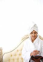 Mature woman awaiting spa treatment