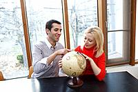 Couple lookin at globe