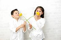 Children smelling flowers