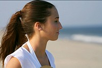 Young brunette woman at the beach, close_up, selective focus