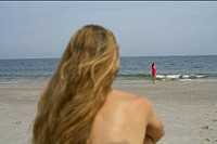 Blond woman looking at the sea, selective focus