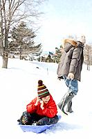 Father and son at play sledding