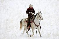 A cowboy out for a winter ride, Shell, Wyoming, Usa