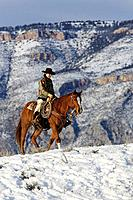 Cowgirl out for a ride in winter. Usa