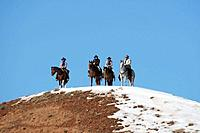 Cowboys out for a ride in winter, Shell, Wyoming. Usa