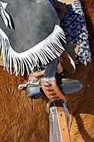 Close-up of a young cowboy's boot in a stirrup, Shell, Wyoming. Usa