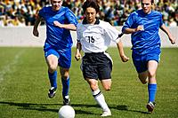 Soccer Player Dribbling Past Defenders (thumbnail)