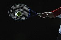 Tennis Player Swinging at Ball