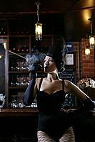 Young sexy woman smoking in burlesque bar.