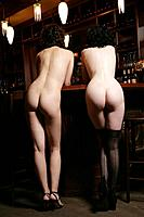 Young nude women standing in burlesque bar