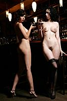 Young nude women having drinks in burlesque bar.