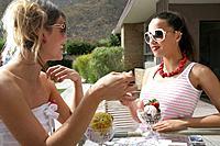 Young stylish women eating ice cream.