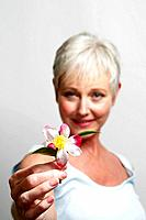 Mature woman holding flower