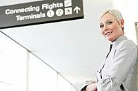 Portrait of mature woman in airport (thumbnail)