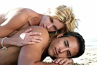 Sexy nude couple laying on beach (thumbnail)
