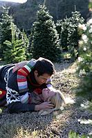 Young couple kissing outdoors in winter
