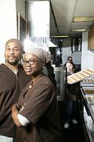 African American workers in kitchen.