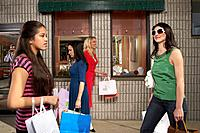 Women and teenage girl 14_16 walking past jewellery store
