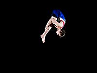 Male gymnast 16_17 mid air, black background
